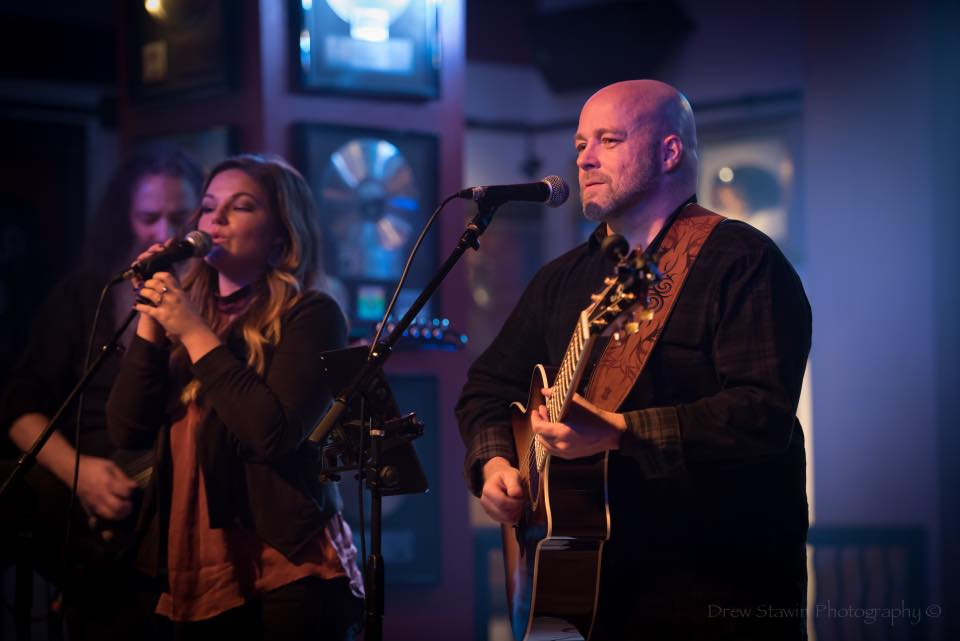 Glen Pridgen and Sommer Pridgen on stage at Hard Rock Cafe in Atlanta.
