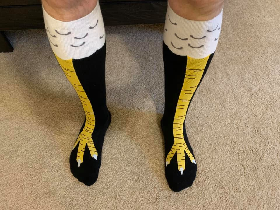 Glen wearing chicken leg socks.